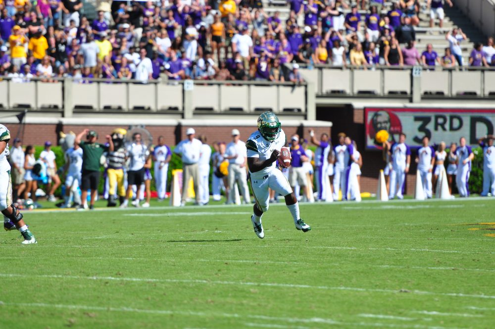 Standout Bulls quarterback Quinton Flowers finds open field against the Pirates. The senior threw for 160 yards and two touchdowns and rushed for 93 yards and a touchdown. (Photo by Bonesville Staff)