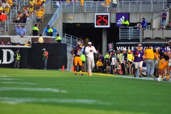 Second year head coach, Scottie Montgomery talks with senior defensive back, Chris Love during the second half of Saturday's 64-17 loss to nationally ranked Virginia Tech. (Photo by Bonesville Staff)