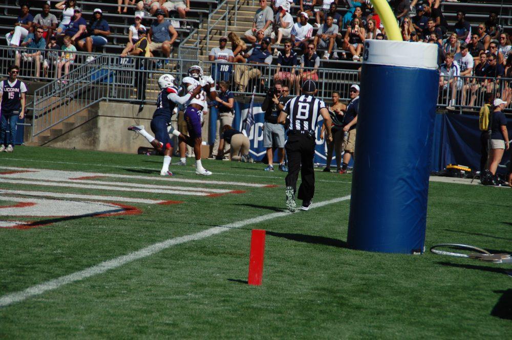 Davon Grayson cradles his second touchdown reception for the Pirates. (Photo by Al Myatt)