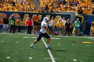 East Carolina punter Austin Barnes gets ready to put his foot in the football. (Photo by Al Myatt)
