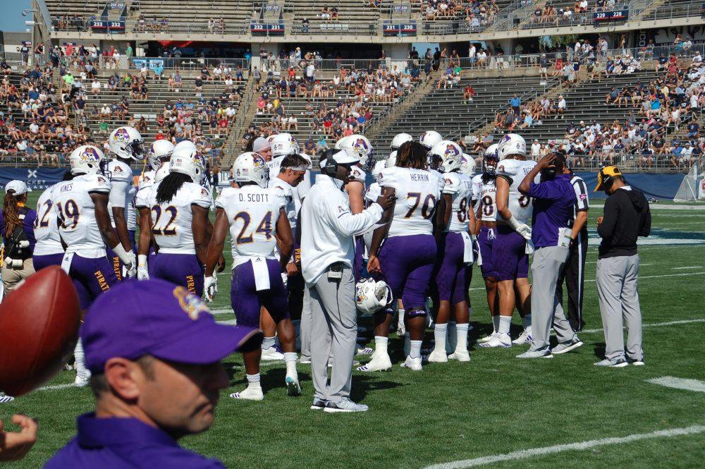 East Carolina's offensive unit huddles up on Sunday afternoon, (Photo by Al Myatt)