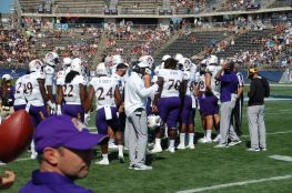 East Carolina's offensive unit huddles up on Sunday afternoon, (Photo by Al Myatt)