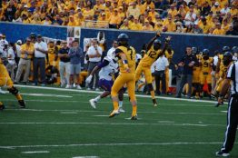 Gary Jennings Jr. (12) makes a reception for West Virginia. (Photo by Al Myatt)