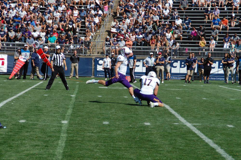 Pirate kicker Jake Verity swings his foot for an extra point. (Photo by Al Myatt)