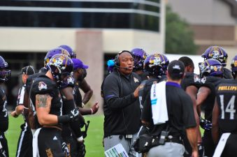 Associate head coach and defensive coordinator Robert Prunty talks with the defense during a timeout. The ECU defensive unit allowed 523 yards of total offense in a 34-10 American Athletic Conference loss to Temple. (Photo by Bonesville Staff)