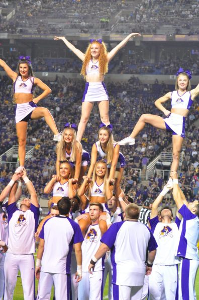 East Carolina cheerleaders were rising to the occasion on homecoming. (Photo by Al Myatt)