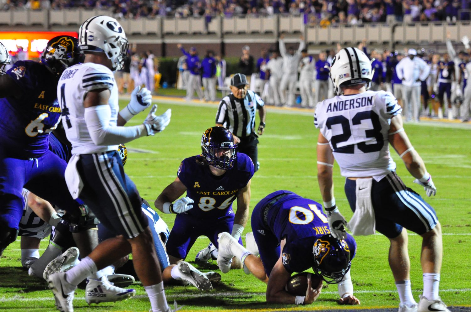 ECU quarterback Thomas Sirk cradles the ball in the end zone after scoring on a 4th-and-goal play at the BYU 1-yard line for the Pirates' first touchdown Saturday night. (Photo by Al Myatt)