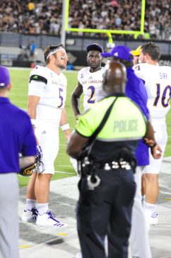 East Carolina quarterbacks Gardner Minshew (5), Kingsley Ifedi (2) and Thomas Sirk (10) communicate on the sideline. (Photo by Al Myatt)