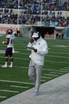 ECU coach Scottie Montgomery checks his play sheet. (Photo by Al Myatt)