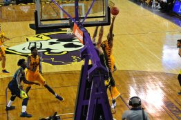ECU senior B.J. Tyson drives to get a shot up in the paint. (Photo by Al Myatt)