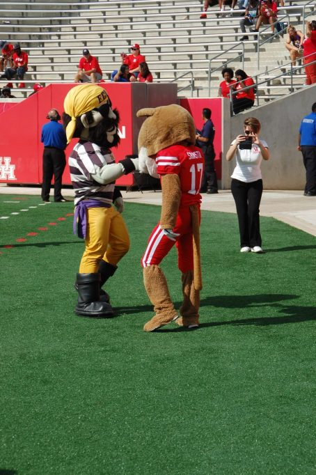 The mascots get together on the sideline during Saturday's American Athletic Conference matchup. (Photo by Al Myatt)