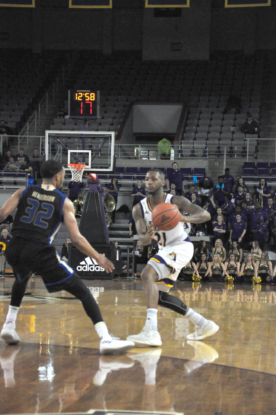 B.J. Tyson sees the floor in a 72-58 loss to Tulsa in his last home game. (Photo by Al Myatt)