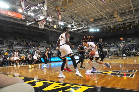 East Carolina graduate transfer Aaron Jackson, who was recognized on Senior Night goes to the basket. (Photo by Al Myatt)