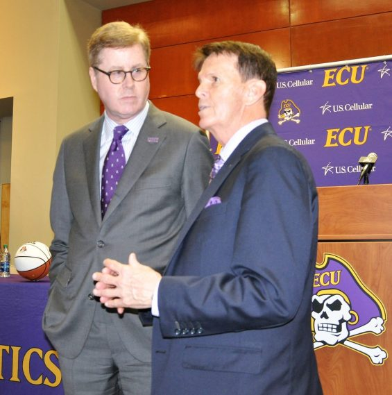ECU chancellor Dr. Cecil Staton (left) converses with special athletic advisor Dave Hart on Thursday.