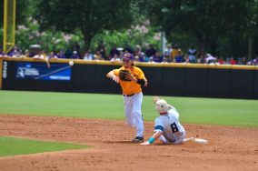 Second baseman Brady Lloyd attempts to turn a double play in Sunday afternoon's elimination matchup with UNC-Wilmington. (Photo by W.A. Myatt)