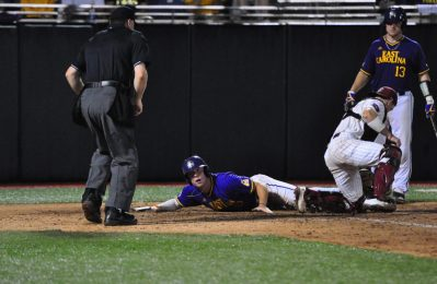 All-America selection Bryant Packard looks for the call as he slides safely into home to pull the Pirates within one run of the Gamecocks (3-2) in the top of the sixth inning. (Photo by W.A. Myatt)