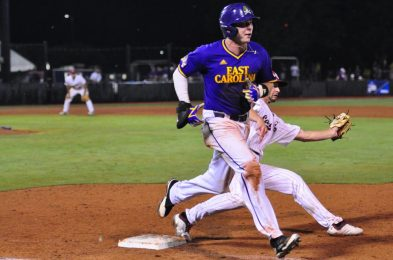 Leftfielder Bryant Packard narrowly beats the toss to first to record his third hit of the night against South Carolina. (Photo by W.A. Myatt)