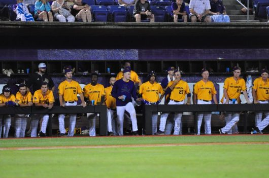The ECU dugout sported rally caps to no avail in the ninth inning of Sunday's Greenville Regional elimination contest with UNCW. (Photo by W.A. Myatt)