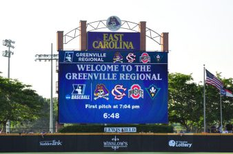 The scoreboard in right-center field of Clark-LeClair Stadium displays the participants in the Greenville regional of the 2018 NCAA baseball tournament. (Photo by W.A. Myatt)