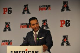 Kevin Negandhi of ESPN served as moderator at the AAC football media day. (Photo by Al Myatt)