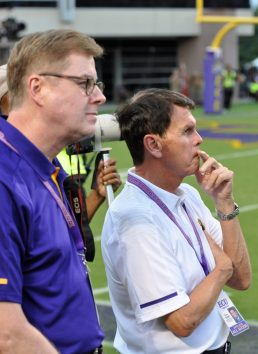 ECU chancellor Dr. Cecil Staton (left) and Dave Hart, athletic advisor to the chancellor, voiced their support of Scottie Montgomery this week. They watch the final stages of a 41-19 win over North Carolina. (Photo by Al Myatt)