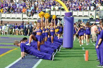 ECU cheerleaders do pushups after the Pirates took a 21-16 lead. (Photo by Al Myatt)