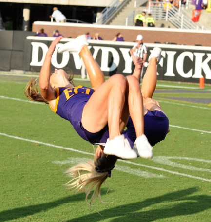 ECU cheerleaders were flipping for the Pirates. (Photo by Al Myatt)
