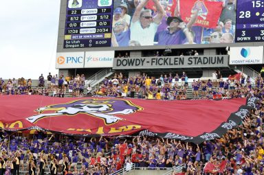 The No Quarter flag is unfurled in the Boneyard at the East end of Dowdy-Ficklen Stadium. (Photo by Al Myatt)