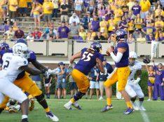 True freshman Holton Ahlers of ECU looks for a receiver in a 37-35 win. (Photo by Al Myatt)