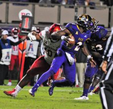 ECU quarterback Kingsley Ifedi (2) is pressured by 2017 Outland Trophy winner Ed Oliver (10) of the Cougars. (Photo by Al Myatt)