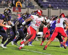 Houston junior Ed Oliver (10) is expected to be a high draft choice. (Photo by Al Myatt)