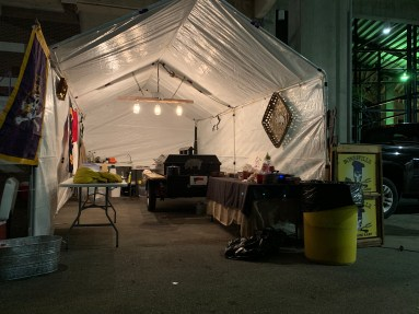 The Bonesville Pig Cooking Crew's booth underneath the north stands of Dowdy-Ficklen Stadium.