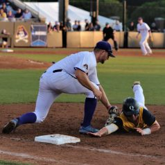 Spencer Brickhouse makes a tag at first on a successful pickoff. (Photo/Dunn Area Sports/Paul Burgett)