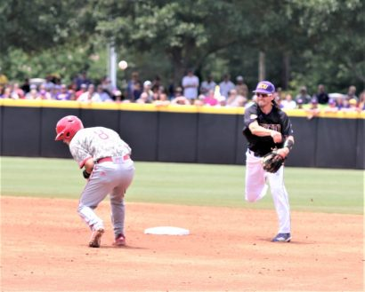Brady Lloyd turns a double play for the Pirates in the third inning. (Photo/Dunn Area Sports/Paul Burgett)