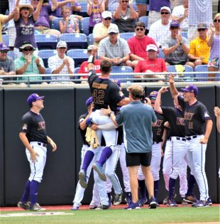 Spencer Brickhouse gets a lift and high fives after scoring for ECU. (Photo/Dunn Area Sports/Paul Burgett)