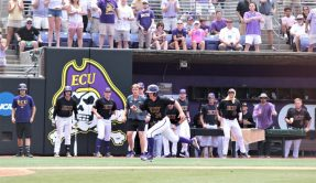 The Pirates watch Chandler Jenkins motor toward home in the big third inning. (Photo/Dunn Area Sports/Paul Burgett)