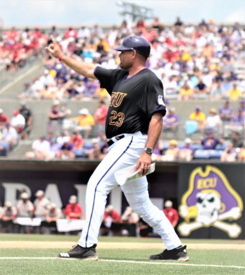 ECU coach Cliff Godwin gives the signal to a runner at second base. (Photo/Dunn Area Sports/Paul Burgett)