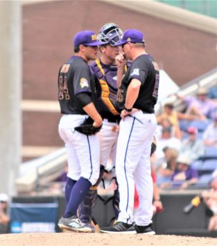 Pitching coach Dan Roszel (right) makes a visit with Jake Agnos (left) and catcher Jake Washer. (Photo/Dunn Area Sports/Paul Burgett)