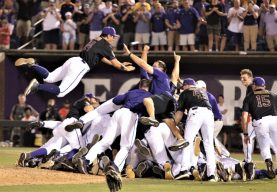 Jake Agnos (14) descends on the dog pile after a 12-3 regional-clinching win. (Photo/Dunn Area Sports/Paul Burgett)
