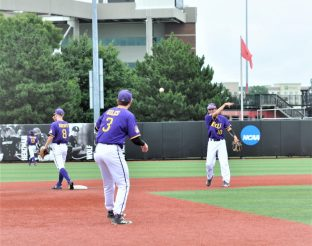Pirate infielders Ryder Giles and Brady Lloyd (right) fire the ball around the infield after a strikeout. (Photo by Al Myatt)
