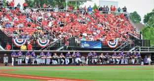 The Pirates are in the third-base dugout at Louisville's Jim Patterson Stadium. (Photo by Al Myatt)