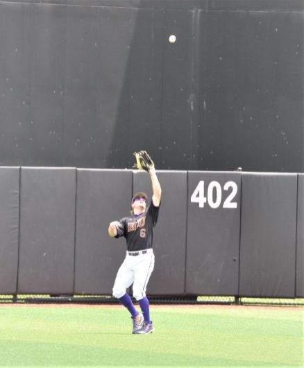 Dusty Baker of ECU is camped under a fly ball in center field. (Photo by Al Myatt)