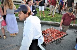 A tray of lobster is transported for consumption on Monday evening at the clambake. (Photo by Al Myatt)