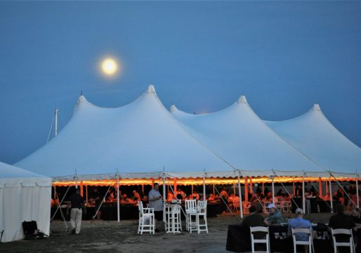 As the sun was setting, the moon rose behind the tent where the gathering enjoyed their meal. (Photo by Al Myatt)