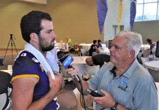 Quarterback Reid Herring takes questions from WNCT-TV sports director and Bonesville columnist Brian Bailey on Saturday. (Photo by Al Myatt)