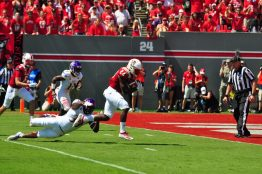NCSU running back Zonovan Knight eludes a tackle from ECU linebacker Brice Bivens en route to the Wolfpack's first touchdown (W.A. Myatt photo)
