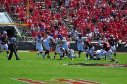 ECU quarterback Holton Ahlers rushes through the middle of the line after a pass play breaks down against North Carolina State. (W.A. Myatt photo)