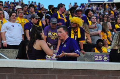 ECU interim chancellor Dan Gerlach interacts with fans during Saturday night's home opener against Gardner-Webb. (W.A. Myatt photo)