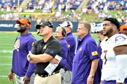 ECU coach Mike Houston watched action on the giant screen with Navy in the red zone