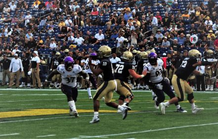 Navy quarterback Malcolm Perry (10), shown throwing deep, accounted for six touchdowns on Saturday